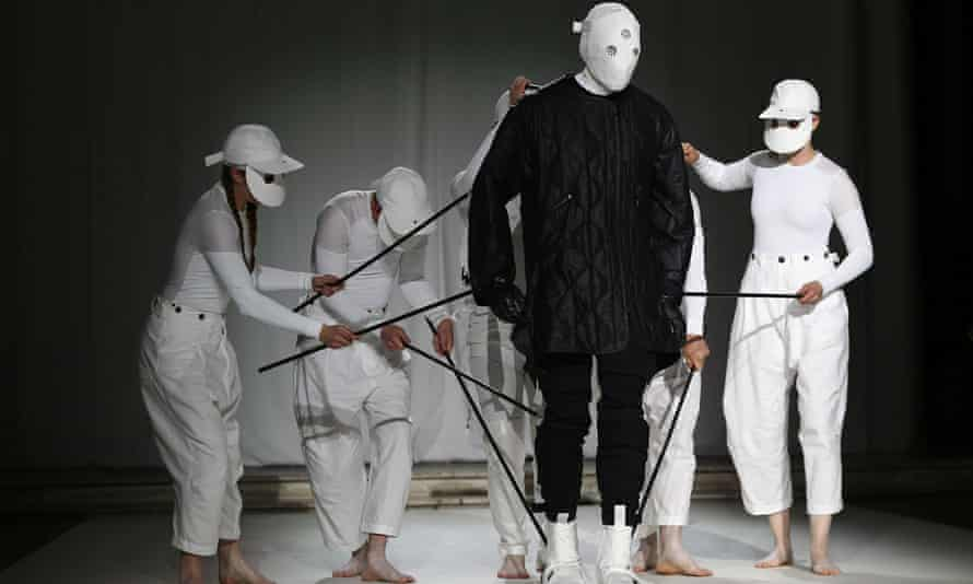 Puppeteers perform with a puppet model at the Aitor Throup show.
