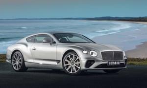 Bentley Continental GT silver shot against a coastal scene