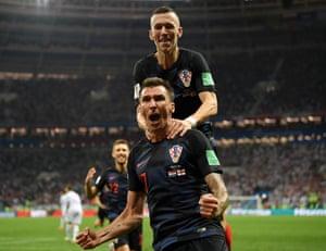 Mario Mandzukic celebrates with Ivan Perisic after scoring Croatia's opening goal against Russia.