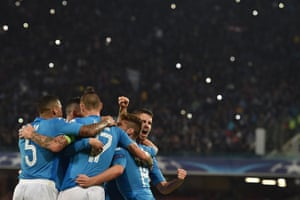Jorginho is congratulated by his team-mates after his penalty put  Napoli back on level terms.