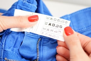 Woman examining washing instruction label