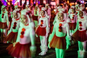 Performers take part in a street parade to mark the lunar New Year celebrations for the Year of the Dog.