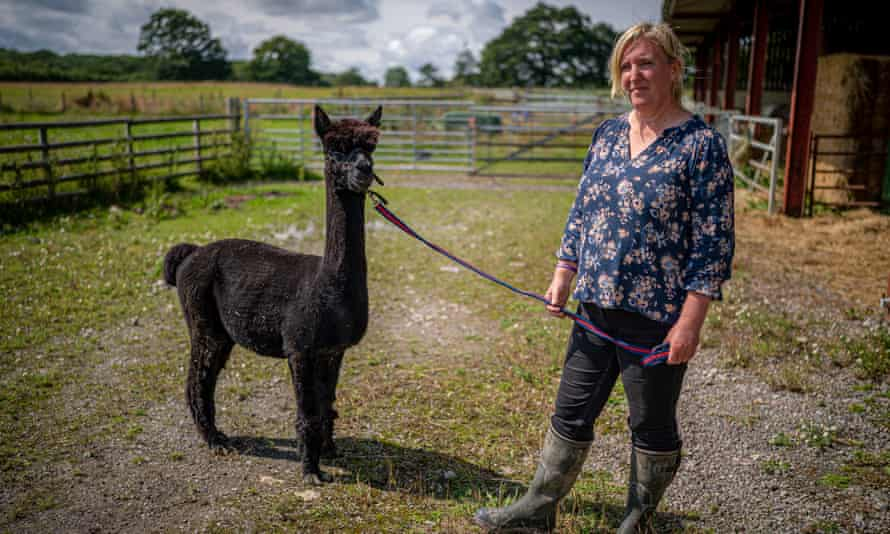 Geronimo with his owner, Helen MacDonald at her farm in Gloucestershire.