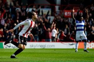 Jota celebrates scoring the third Brentford goal against QPR at Griffin Park.