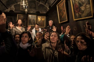 Pilgrims pray inside the Grotto in the Church of the Nativity in the West Bank town of Bethlehem.