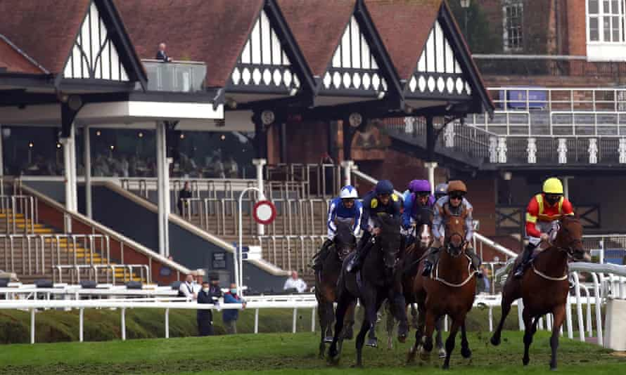 Runners and riders round the bend during the Eatouttohelpout At The White Horse Handicap at Chester Racecourse on 10 August 2020