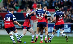 Bristol congratulate Ian Madigan after his late penalty sealed victory over Saracens.