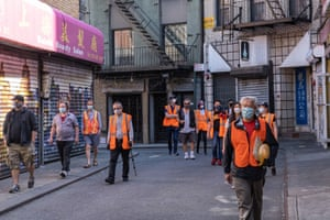 Karlin Chan, a volunteer for the Chinatown Block Watch, patrols the neighborhood in New York City on 17 May.