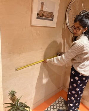 Priscilla Fernandes measuring her workspace, built during lockdown.