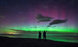 The northern lights over Bamburgh Castle beach in Northumberland