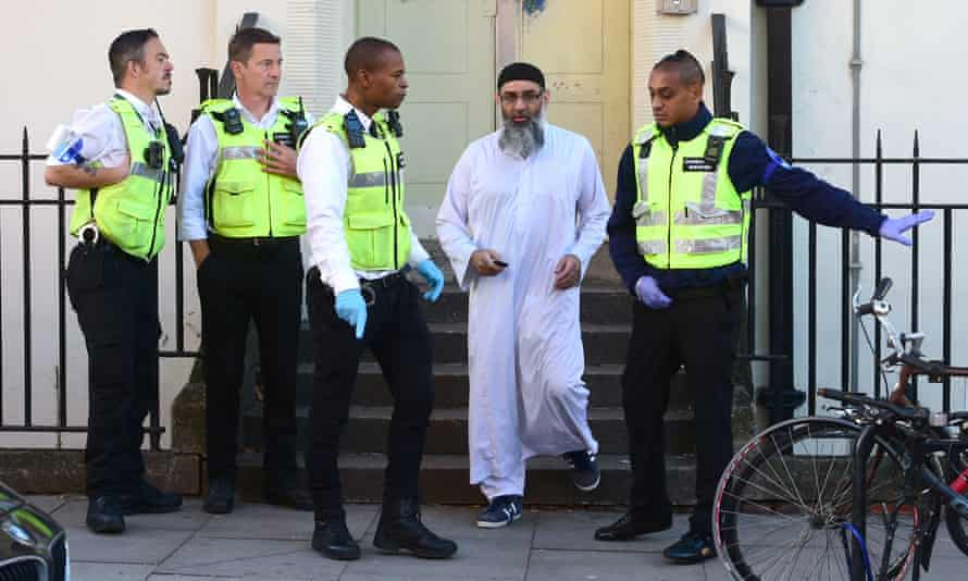 Anjem Choudary leaves a bail hostel in north London after his release from Belmarsh Prison