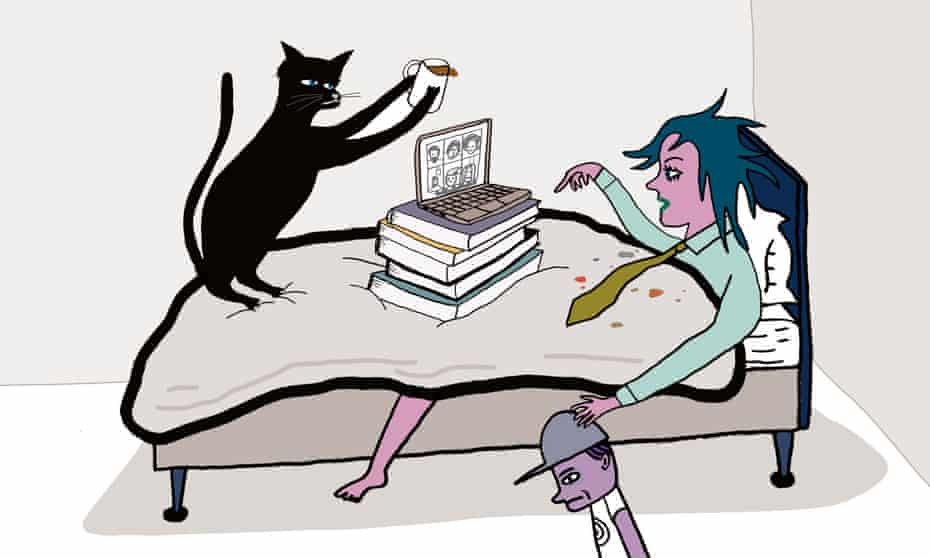 Woman working from bed with a cat, child and hot drink