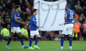 Liverpool fans hold up a banner highlighted the last time Everton won a trophy.