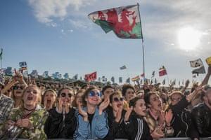Fans watch the 1975 play Glastonbury festival in June 2016