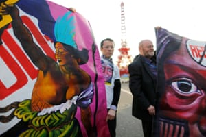 Participants of the No-Redd organisation demonstrate during near the Paris climate talks in Le Bourget