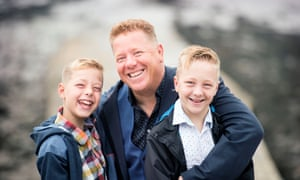 St John (Singe) Greene with his sons Finn, 10, and Reef (right), 12, who survived cancer after his wife Kate had died of breast cancer.