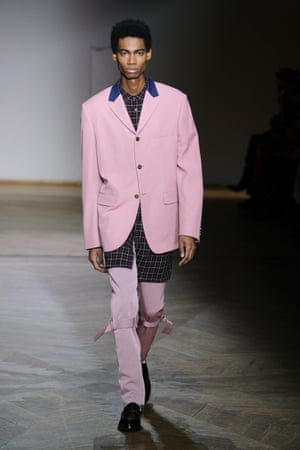 PAUL SMITHIn the late 60s, when he was starting out, Paul Smith would charm local tailors in his hometown of Nottingham into cutting him one-off suits from a pair of curtains and dandyish shirts from old floral dresses. AW19 was a nod to those days, with a suit in an oil painting floral and a manipulated leopard print on shirts. A side of punk came in the bondage strap flight trousers and zips worn with biker boots. Outerwear was based on an old 1930s riding jacket, the vivid colour block shades of tomato red, Pepto- Bismol pink and egg yolk yellow bucked the black is back trend.