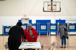 A Somalia-American casts her ballot during the Democratic presidential primary in Minneapolis, Minnesota on Super Tuesday, March 3, 2020.