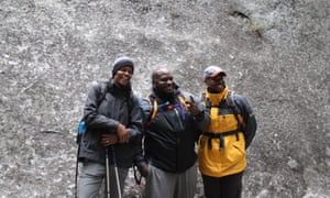 Outdoor Afro participants smile for a picture while on a hike with their group.