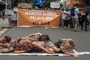 Activists in Rio de Janeiro, Brazil, protest against the collapse of a wastewater dam at an iron ore mine in the River Doce basin