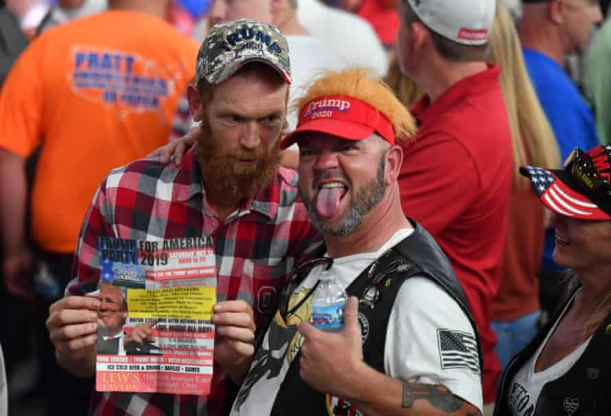 Trump supporters await the arrival of their hero.