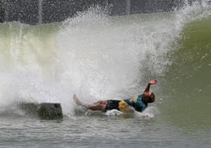 Mick Fanning of Australia wipes out during surfing qualifiers in California