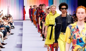 Models present designs by Paul Smith during men's fashion week in Paris