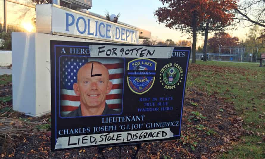 A sign honoring Fox Lake police lieutenant Charles Joseph Gliniewicz is defaced outside Fox Lake police department.