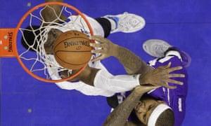 Sacramento Kings' DeMarcus Cousins dunks against Nerlen Noel.