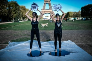 Paris, France: Activists for animal rights group PETA douse themselves with black product in front of the Eiffel Tower during a protest against the use of leather in the fashion industry