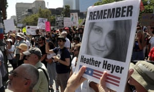 A demonstrator holds up a photo of Heather Heyer during a demonstration against racism in Los Angeles. The Unite the Right rally where Heyer was killed started as a Facebook event.