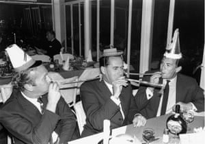 Colin Chapman, left, Jack Brabham and Jim Clark celebrate at a party on New Year's Day 1968 in Kyalami, South Africa
