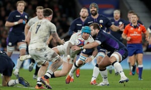 England's Jack Nowell passes under pressure.