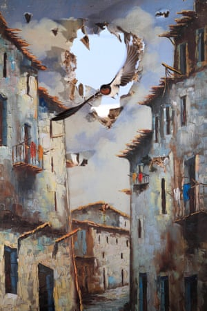Impressions winner:<em> Life comes to art</em> by Juan Tapia (Spain)<br>Tapia made a swallow-sized hole in an oil painting in a old barn and moved it over the window that the swallows entered through, capturing the moment one of the swallows swooped in with the sky behind.