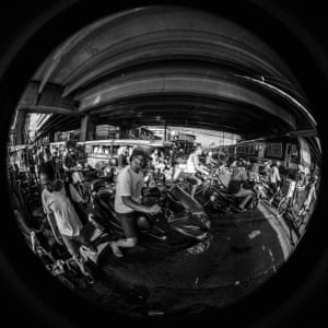 A collision of trains, bikers, jeepneys, pedestrians, trucks, cars, pedicabs in Manila