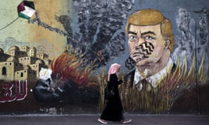 A wall with graffiti depicts Donald Trump with a footprint on his face in Gaza City, on 25 June 2019.