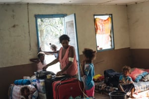 Kwevrie*, 35, packs her family's belongings in preparation to travel by ship from Lone, West Ambae to Santo, following the announcement of mandatory evacuation for all Ambae's 11,000 residents due to the Manaro Volcano. Kwevrie, her husband and five of her children (the three older ones live in Port Villa) moved down to the seaside in April from Lovutialau, their village up on the mountain, due to heavy ashfall. For three months they've slept on mattresses in a church, hoping they could one day return home. Instead, they are evacuating a second time in 12 months.  *name changed