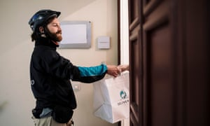 Your dinner, sir … a Deliveroo rider doing his job.