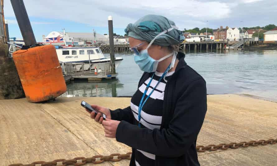 UK National Health Service employee Anni Adams looks at new NHS app trialled on Isle of Wight.