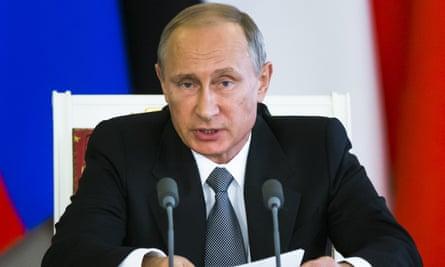 Russian President Vladimir Putin delivers a statement