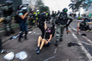 Police drag a protester as she tries to leave the campus