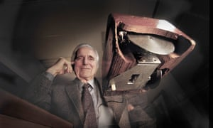 Douglas Engelbart, a pioneer of the human-computer interface, with his prototype wooden mouse.