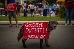 A dog with a placard as Filipino protesters march towards Philippine Congress in Manila to call for an end to Duterte's presidency. Duterte's six-year term has been filled with extrajudicial killings, human rights abuses, corruption, and extreme poverty among Filipinos.