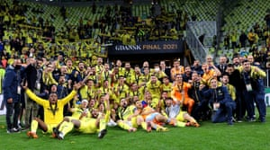 The Villarreal players and staff celebrate in front ot their joyous fans.