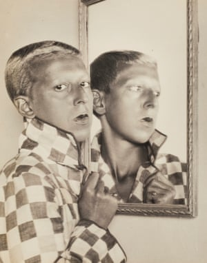 Self-portrait (reflected image in mirror with chequered jacket), 1927 by Claude Cahun.