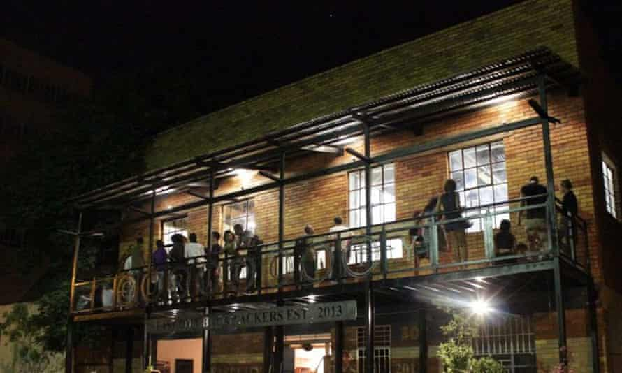 Guests on the bar balcony at Curiocity Backpackers hostel in Johannesburg, South Africa.
