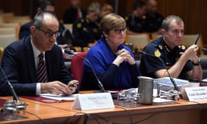 Home affairs department secretary Mike Pezzullo (left) answers questions about refugees and asylum seekers at a Senate estimates hearing