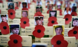 Images of the fallen in Afghanistan on thousands of poppy crosses in the grounds of Westminster Abbey