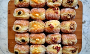 An array of doughnuts laid out on a platter at Twelve Triangles, Edinburgh, Scotland.