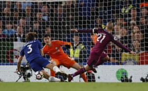 Silva's shot is blocked by Chelsea's Marcos Alonso.